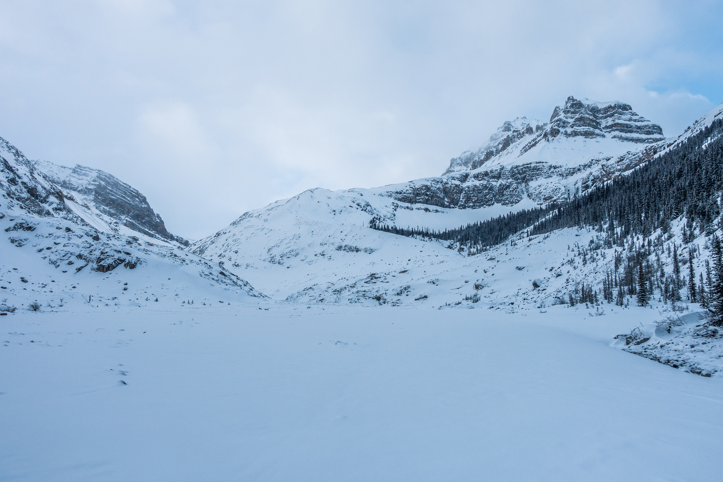 Through the narrows, looking ahead at the moraine (center) and our prize - Peyto Peak rises on the right.