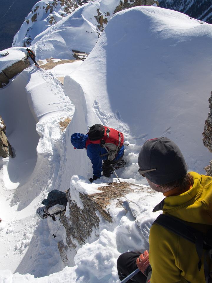 Negotiating the crux on the ridge.