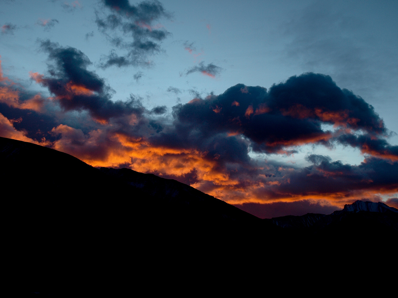 A fiery sunrise along hwy 40. Fisher Peak is just visible on the right hand side of the photo.
