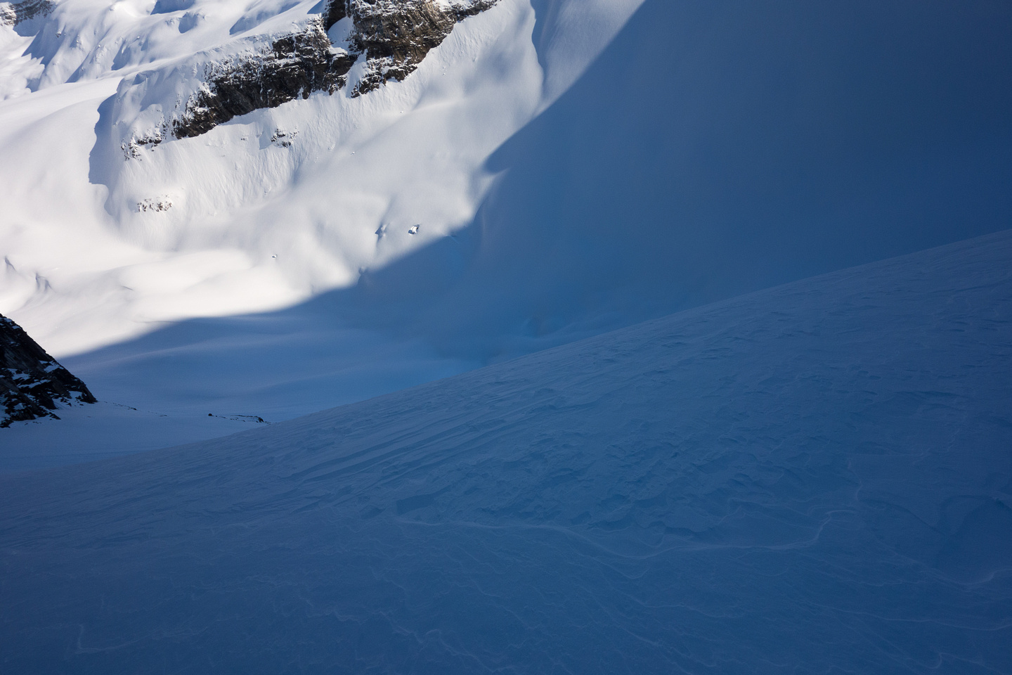 The scary drop over the col onto the Wilson Icefield. Thank goodness it's a north facing slope that never gets sun.