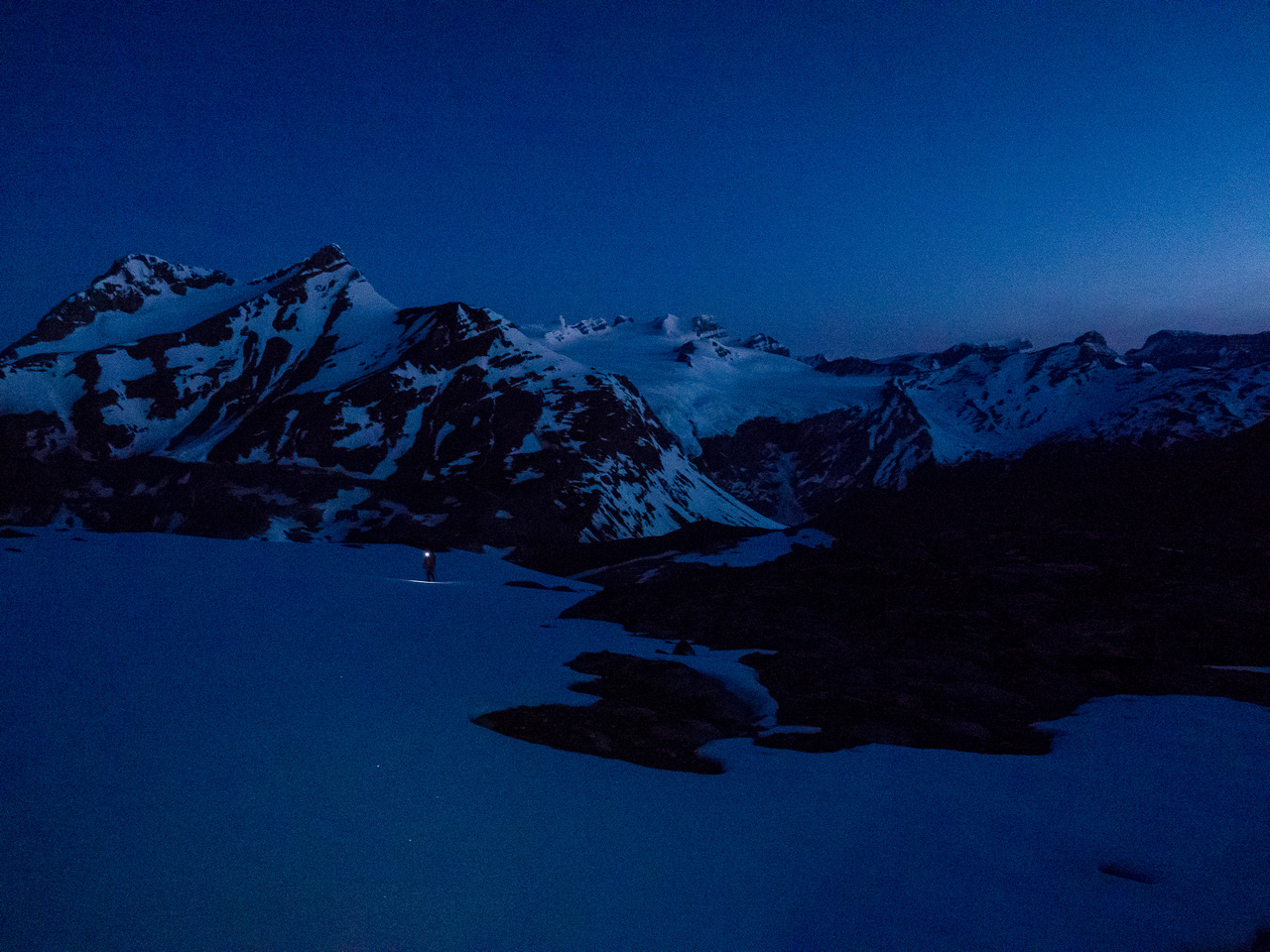 Looking back at Mike and towards the Lyells as we work our way up to the toe of the North Glacier in predawn darkness.