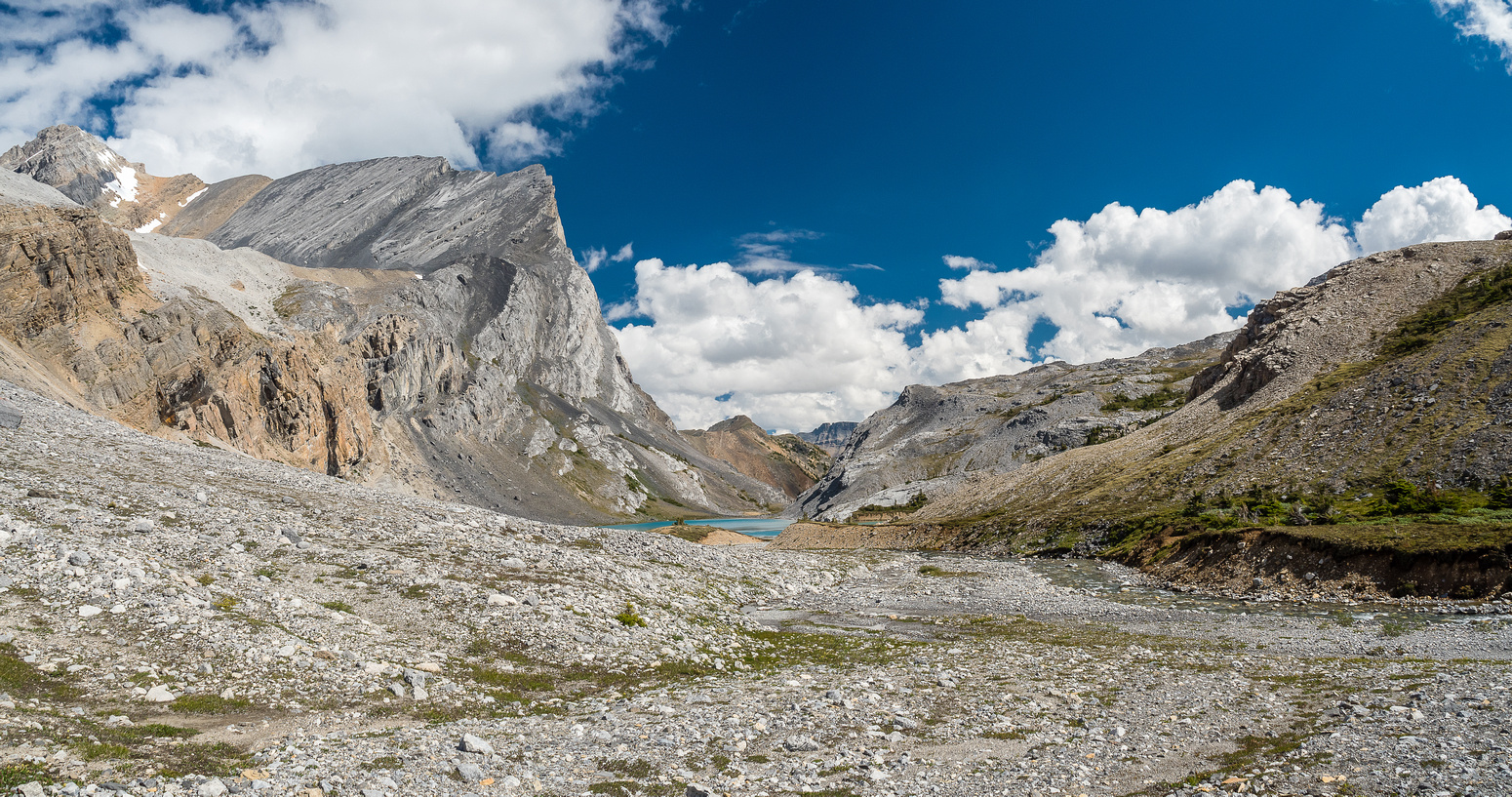 Aries Peak shows up at upper left with Capricorn Lake visible at center in this view looking back from the moraines.
