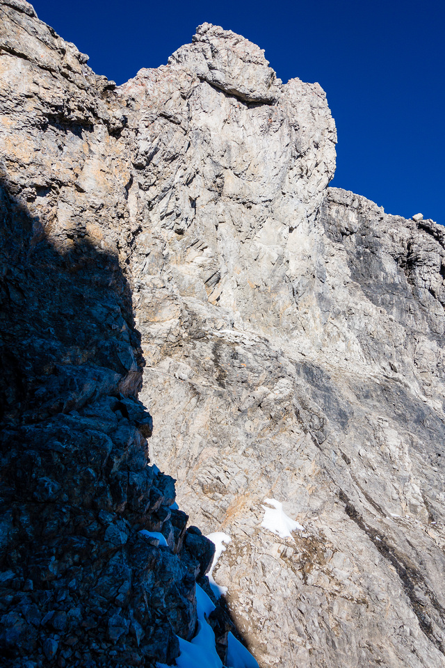 The terrain that you'll have to rappel if you come down from the NW summit to the col.