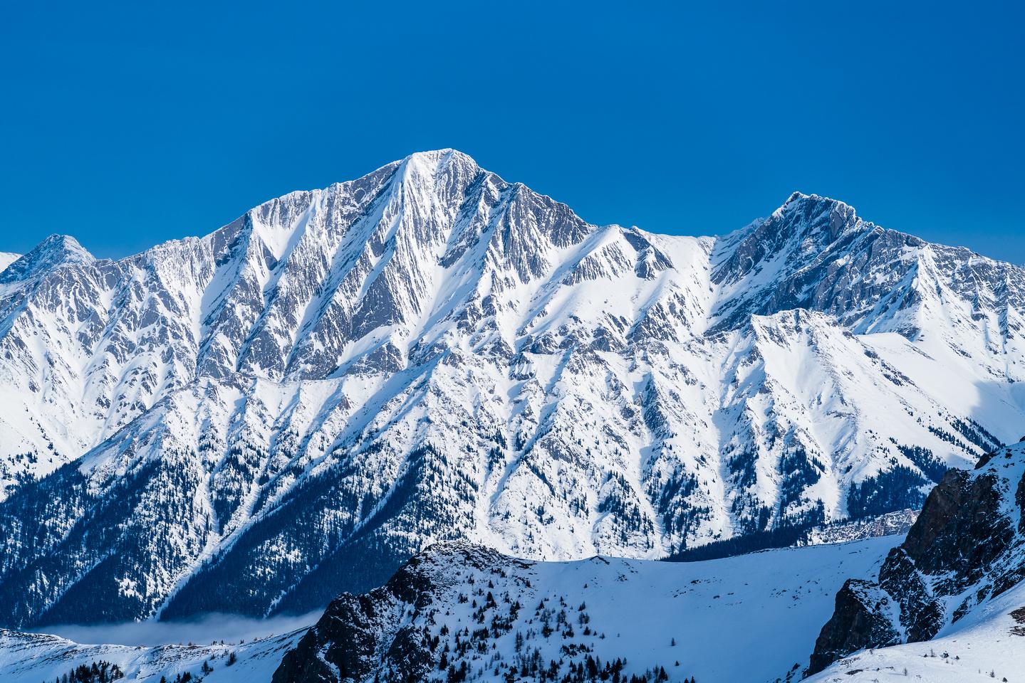 Mystic Peak. Robb completed an FA of the left skyline ridge.