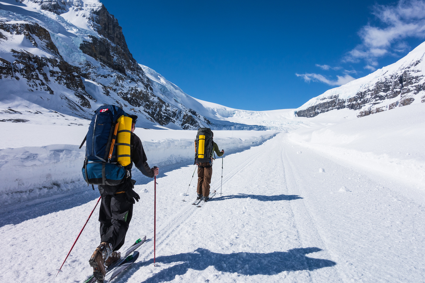 Skinning up the snow coach road on the Athabasca Glacier.