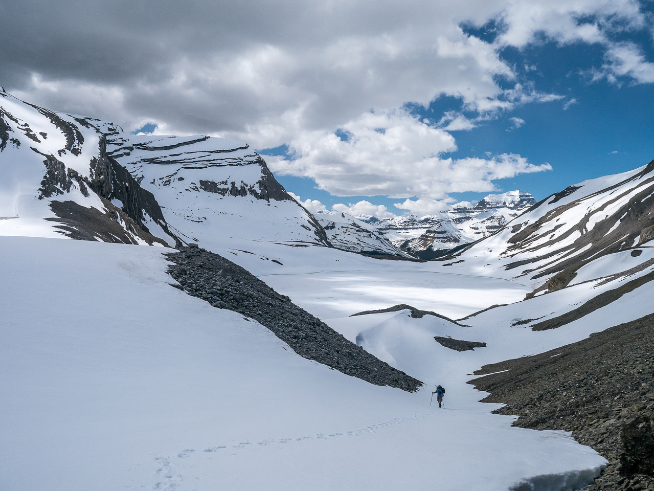 Heading up a snow gully to the pass.