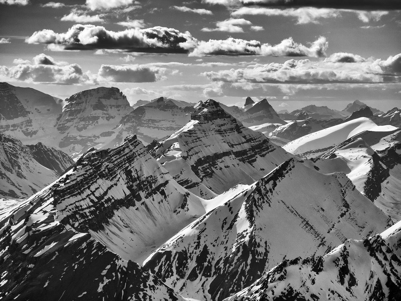 Looking past Nigel Peak at Mount Smythe's distinct double summit. Diadem and Mushroom at left.