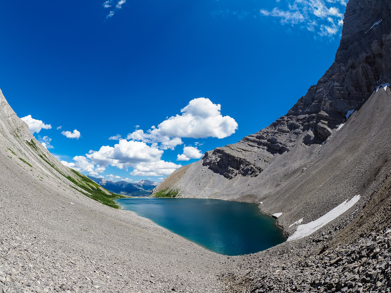A fisheye shot from the back of the lake gives a better sense of the feeling of being under the impressive cliffs of Mount McPhail and Horned Mountain.