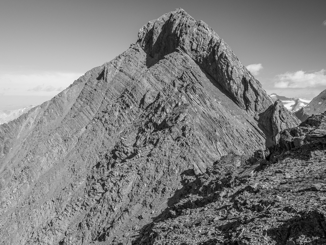 There are some minor undulations on the ridge as you approach the scree traverse to the north end of the summit block.