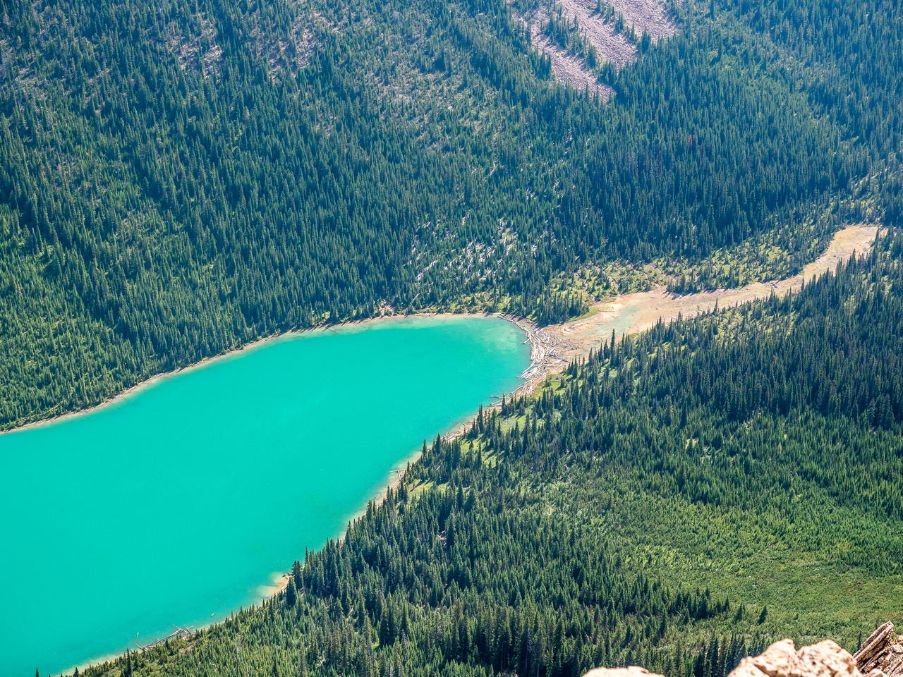 The south end of Sherbrooke Lake with the bottom of Kane's approach avalanche slope at bottom right.