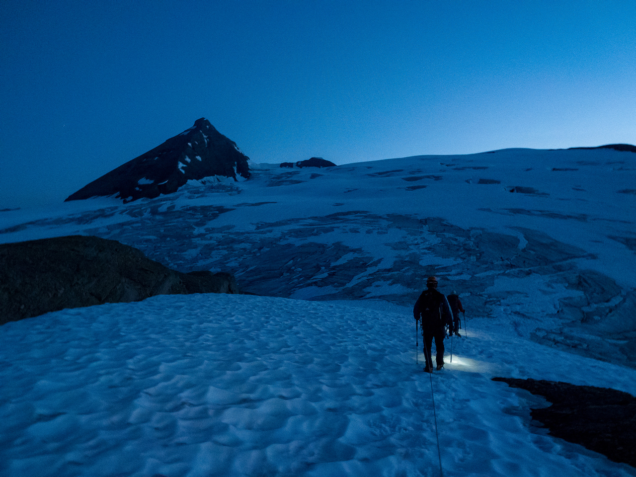 Starting out from camp with just enough light to spot crevasses.