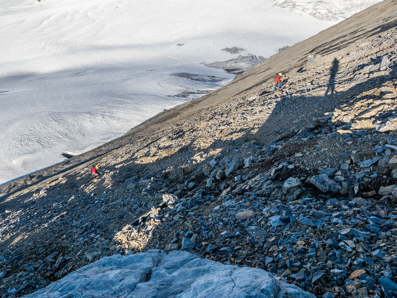 Grinding our way up the south face scree slope now.