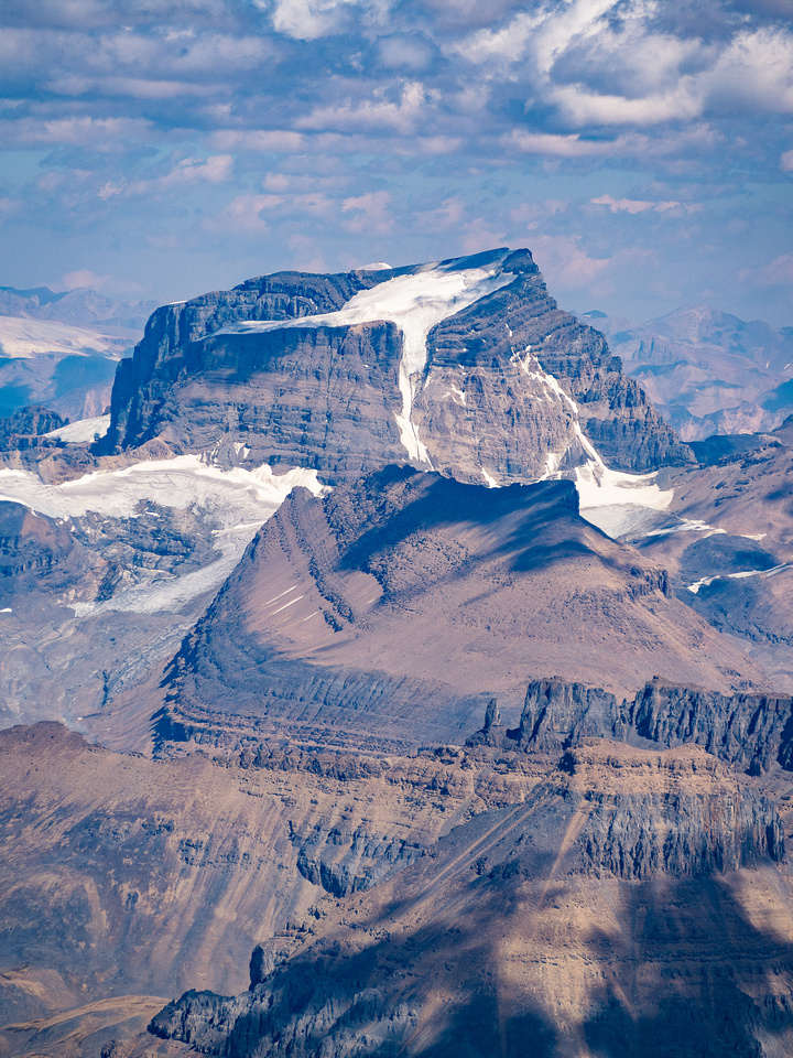 Little Alberta lies in front of Mount Woolley - it's aesthetic south couloir route visible here.