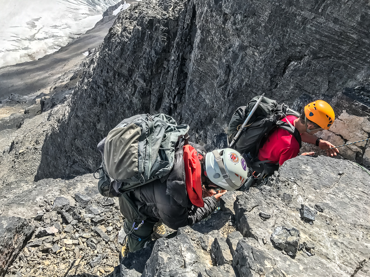 Rigging a mid gully rap station as Ferenc pulls the rope from the upper one.