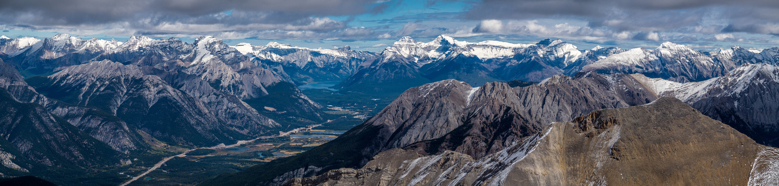 Looking over Banff and Mount Norquay (L) towards Brewster, Cascade, Astley, Aylmer, Inglismaldie, Girouard, Peechee and Rundle