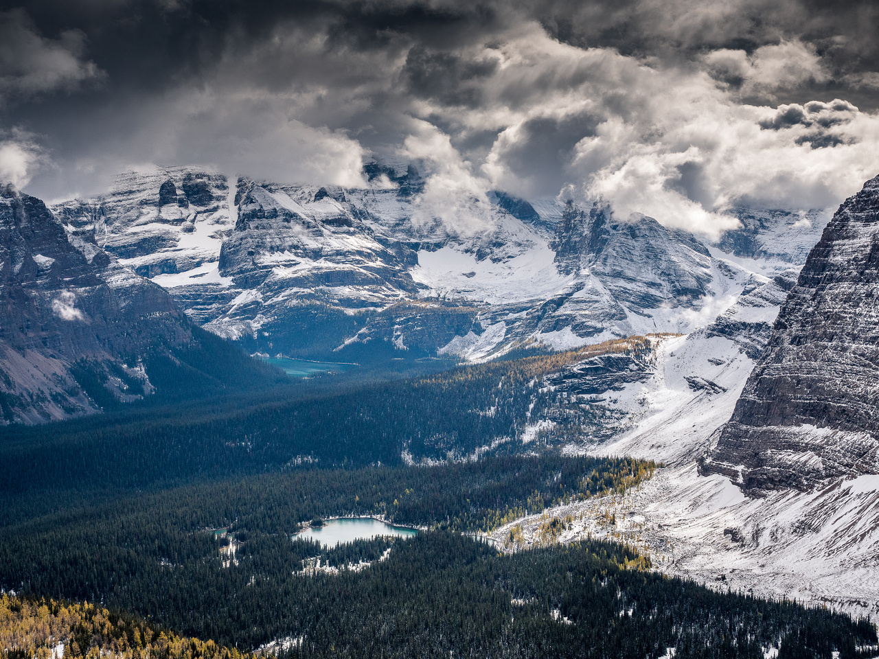Looking over Linda Lake towards Lake O'Hara with Hungabee and other giant peaks rising into the clouds beyond.