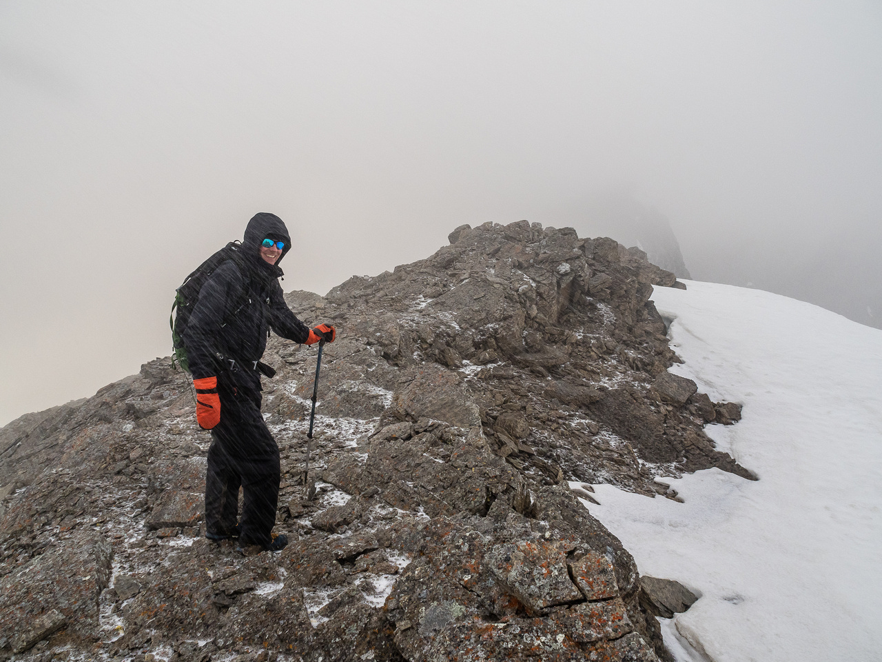 Phil is all smiles despite a snow storm at the end of June at 21:30 high on the Continental Divide.