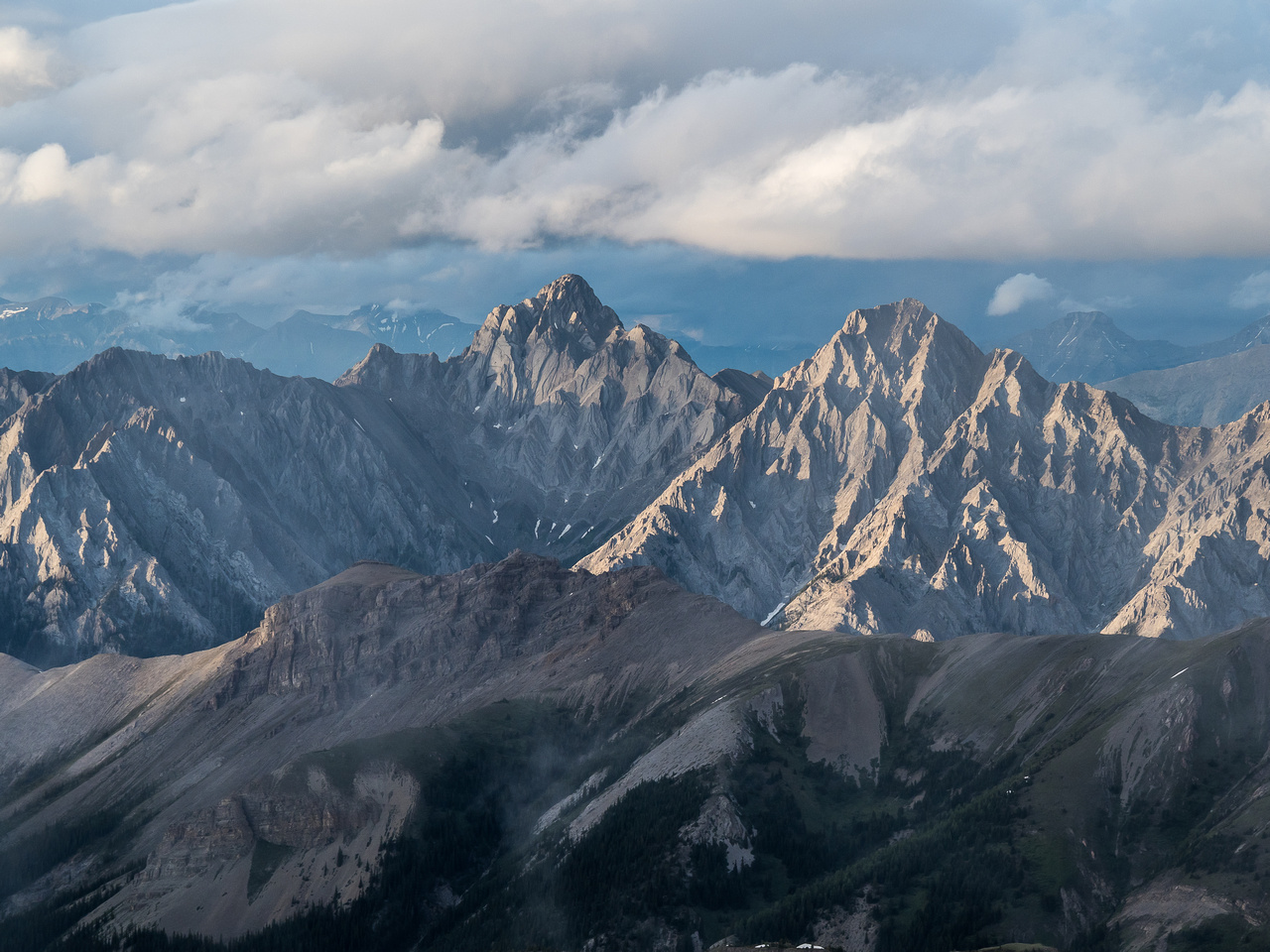 Setting sun highlights the jagged ridges on peaks in the Sundance Range. Good thing not too many of these peaks are named because they don't look easy!