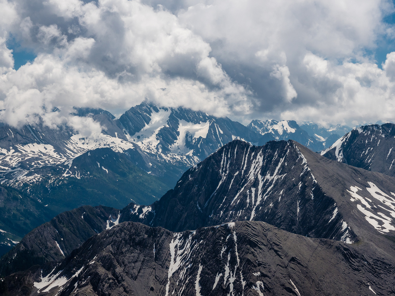 Mount Sir Douglas is buried in clouds beyond Mount Warre.