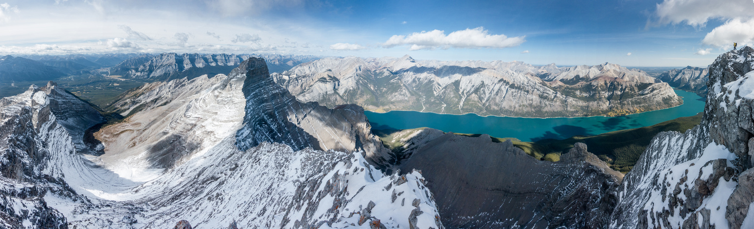 Incredible view over Lake Minnewanka. Steven on the summit ridge to the right.