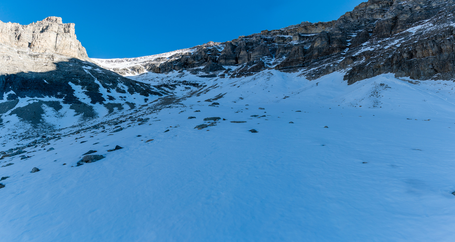 The snow becomes more permanent and our foreshortened route to the summit appears left of center.