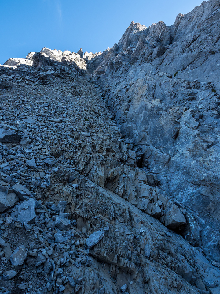 """Note the light brown crumbly rock abutting the """"solid"""" (it's not that solid) gray rock at right."""