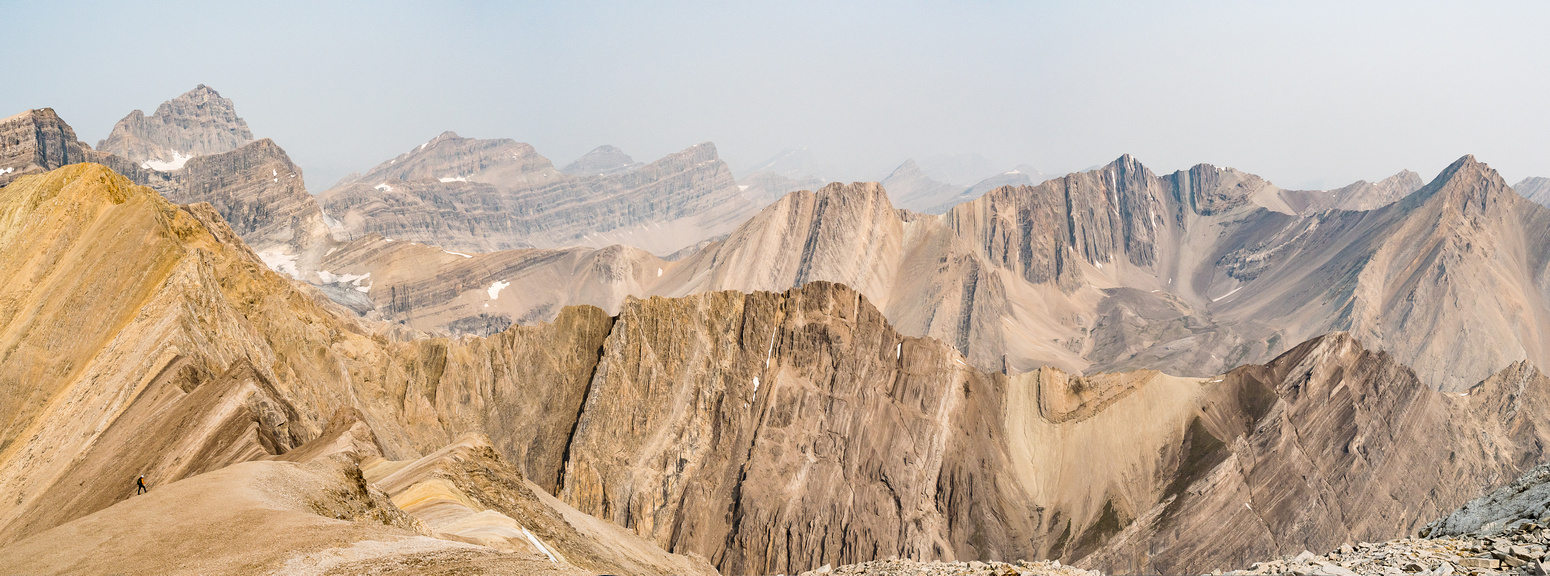 One of my favorite shots from the trip shows a tiny Phil on the west ridge descent of McConnell with a barren desert Rockies landscape fading in smoke to the north.