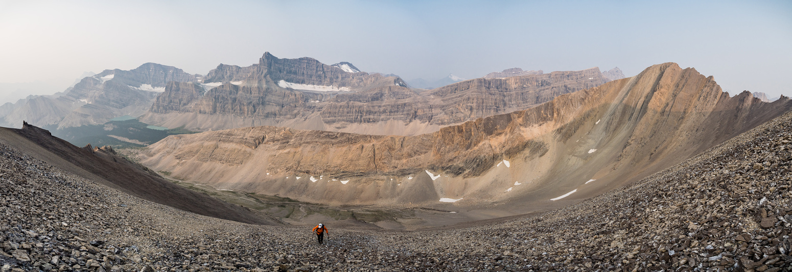 This is a good view of the scree slog on McConnell! Also, the views are opening up behind us including Mount Drummond's huge massif and even Mount Hector barely visible through the smoke at center rig