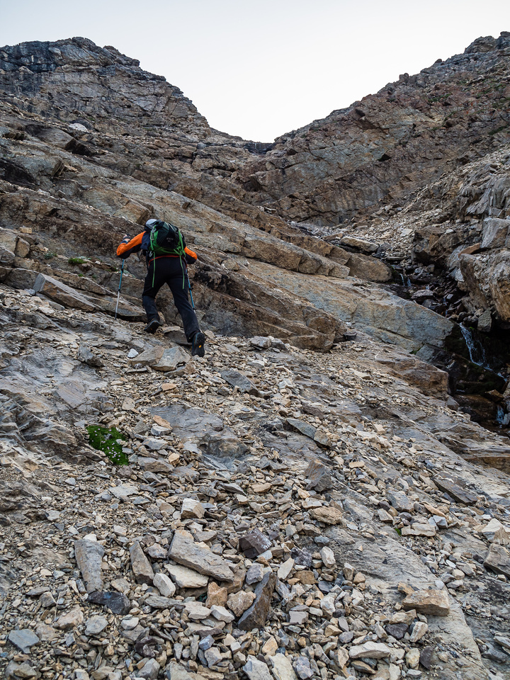 We managed to find some quick and relatively solid slabs lower down before the scree became interminable.