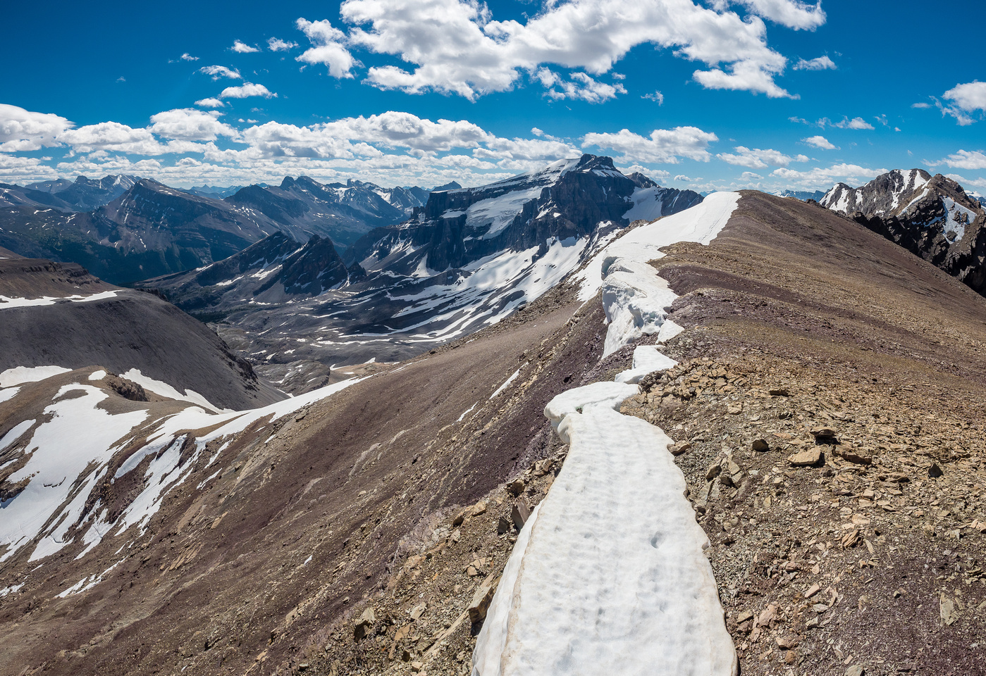 The easy descent slope towards Marmot Mountain goes down the left off the false summit and into the distant valley at left. Silverhorn at distant right here.