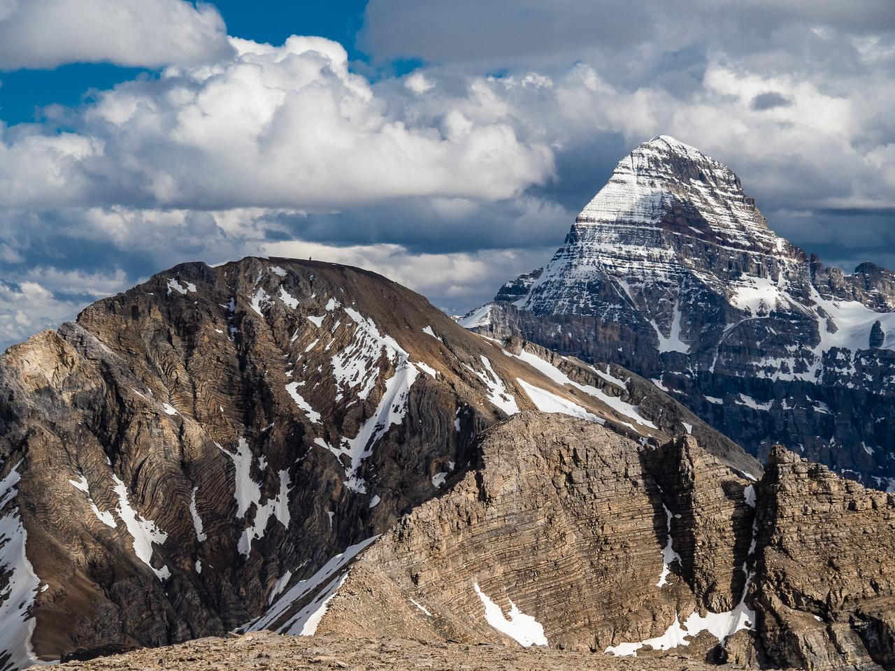 Mount Assiniboine looms over Nestor Peak (L) and Simpson Peak (C).