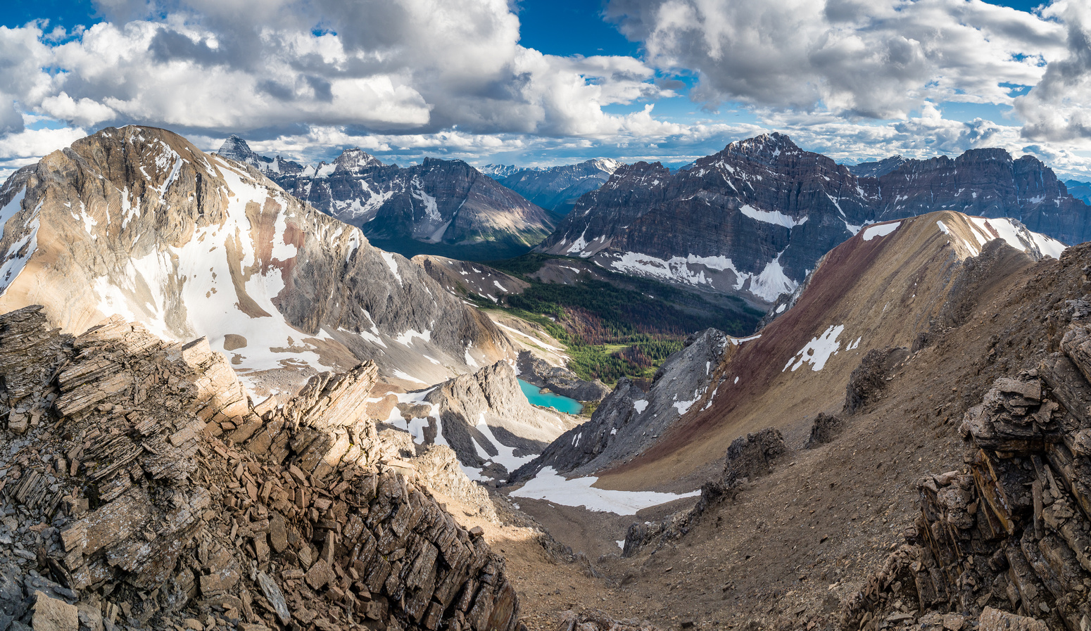 This is why we beat ourselves up so badly to get to these rarely ascended peaks! Nestor Lake is stunning in the late day lighting as is its namesake peak in this view over Ferro Pass towards Nestor Pe