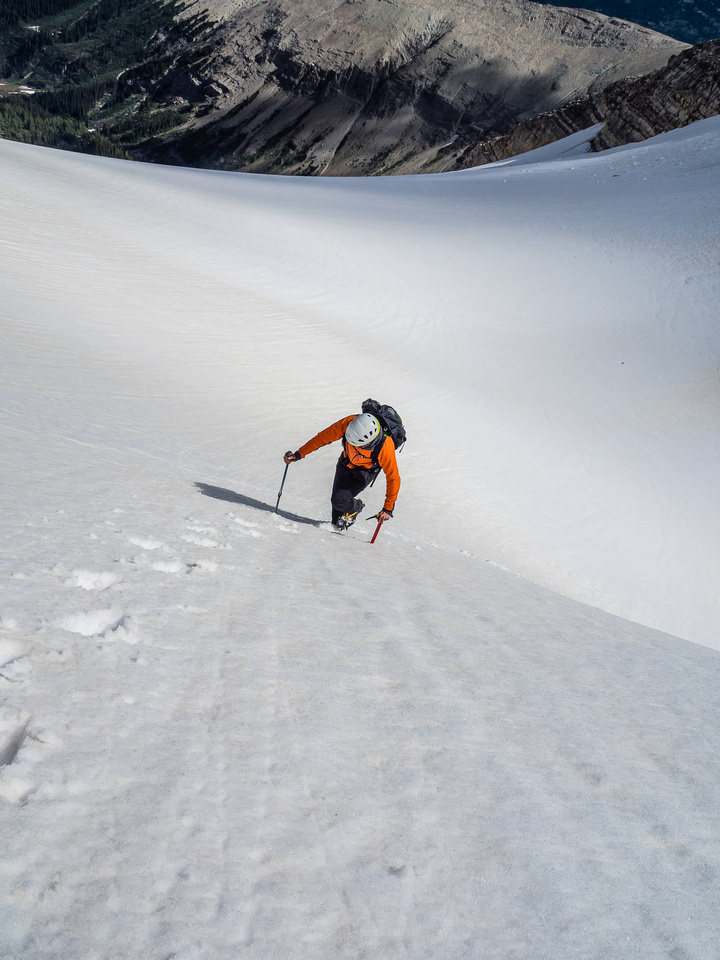 Phil follows me up the snow / glacier to the summit ridge. It's steep - but very low consequence here