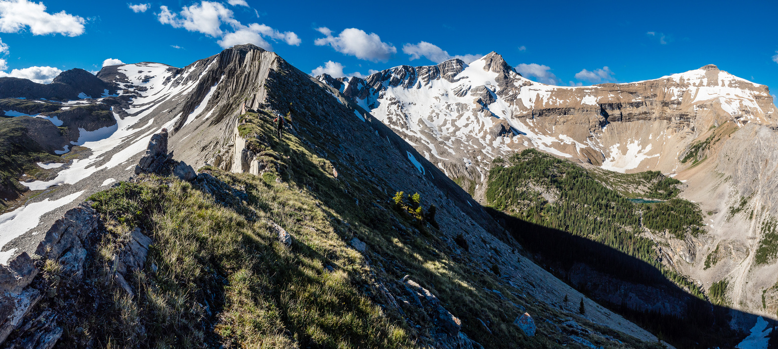 Sublime views off the ridge with Nestor at center and Simpson Peak at right with a tarn sparkling beneath.