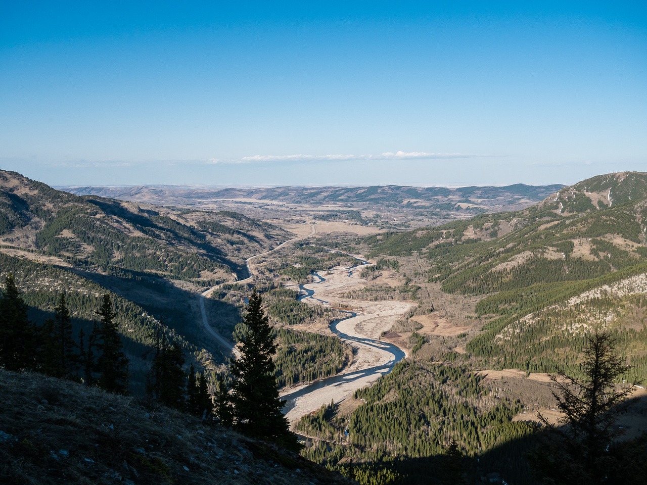 Looking over the Highwood River, through Eyrie Gap towards Eden Valley and the Prairies east of the Rockies.