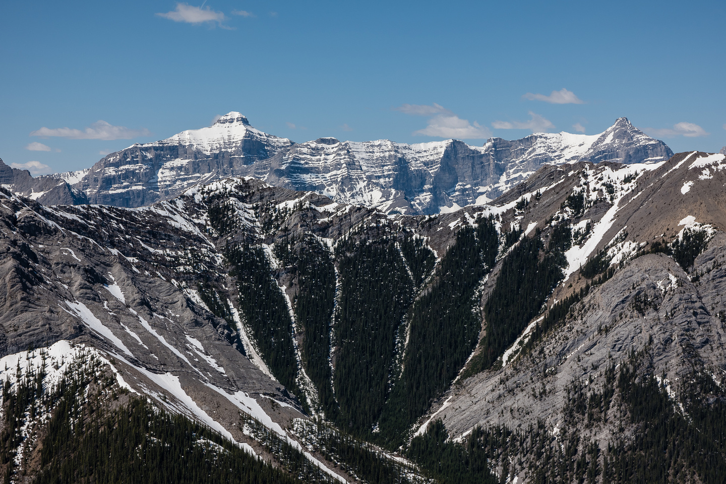 Mount Bogart, Ribbon Peak and Mount Sparrowhawk loom above Kananaskis Peak to the west.