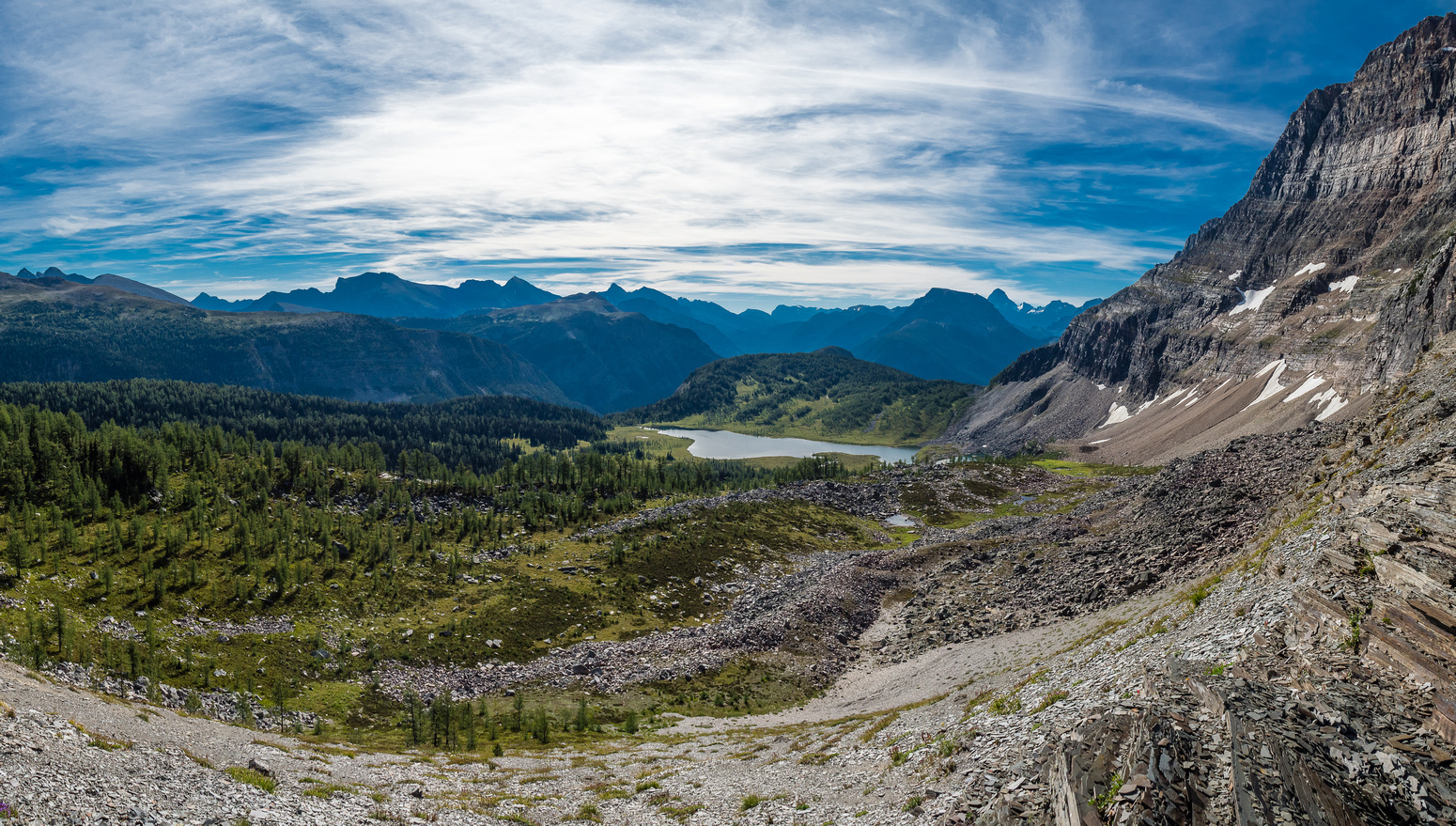 Looking along the impressive east face of The Monarch (R) towards Eohippus Lake and the Mount Assiniboine area.