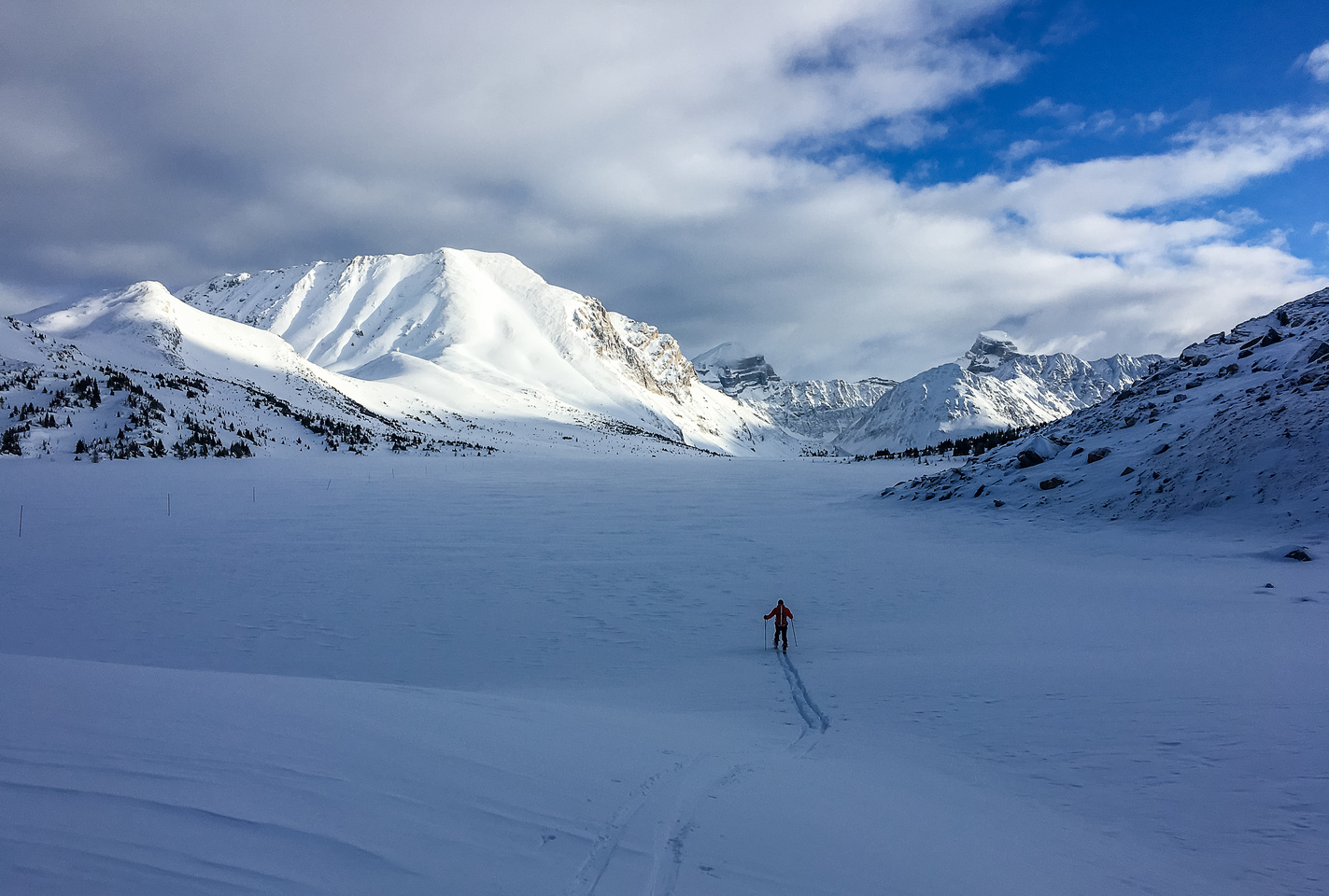 Mike starts breaking trail on Ptarmigan Lake. Packer's Pass Peak and Fossil on the left.