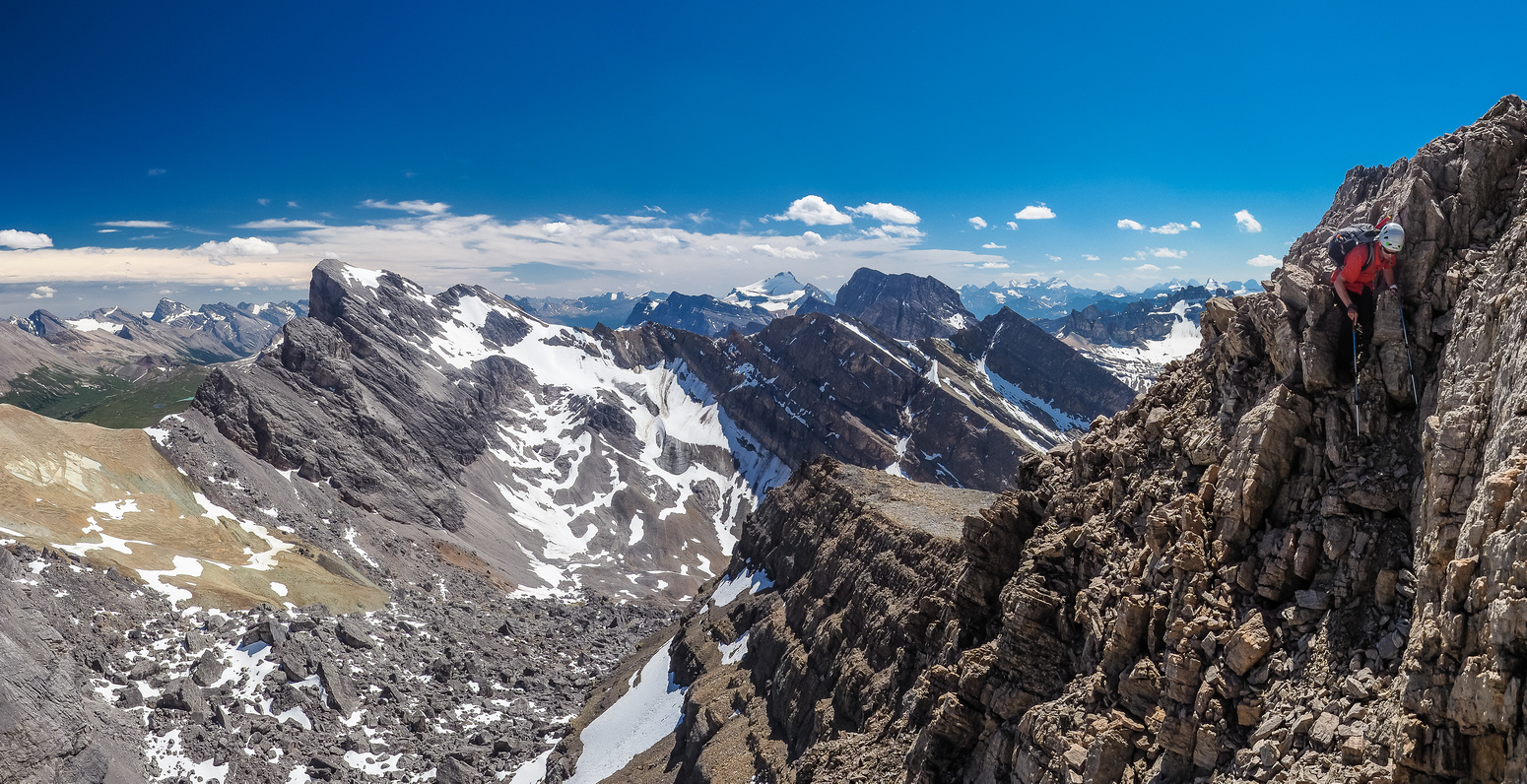 Another exposed move along the east face traverse. At least the weather is holding and the views are still great.