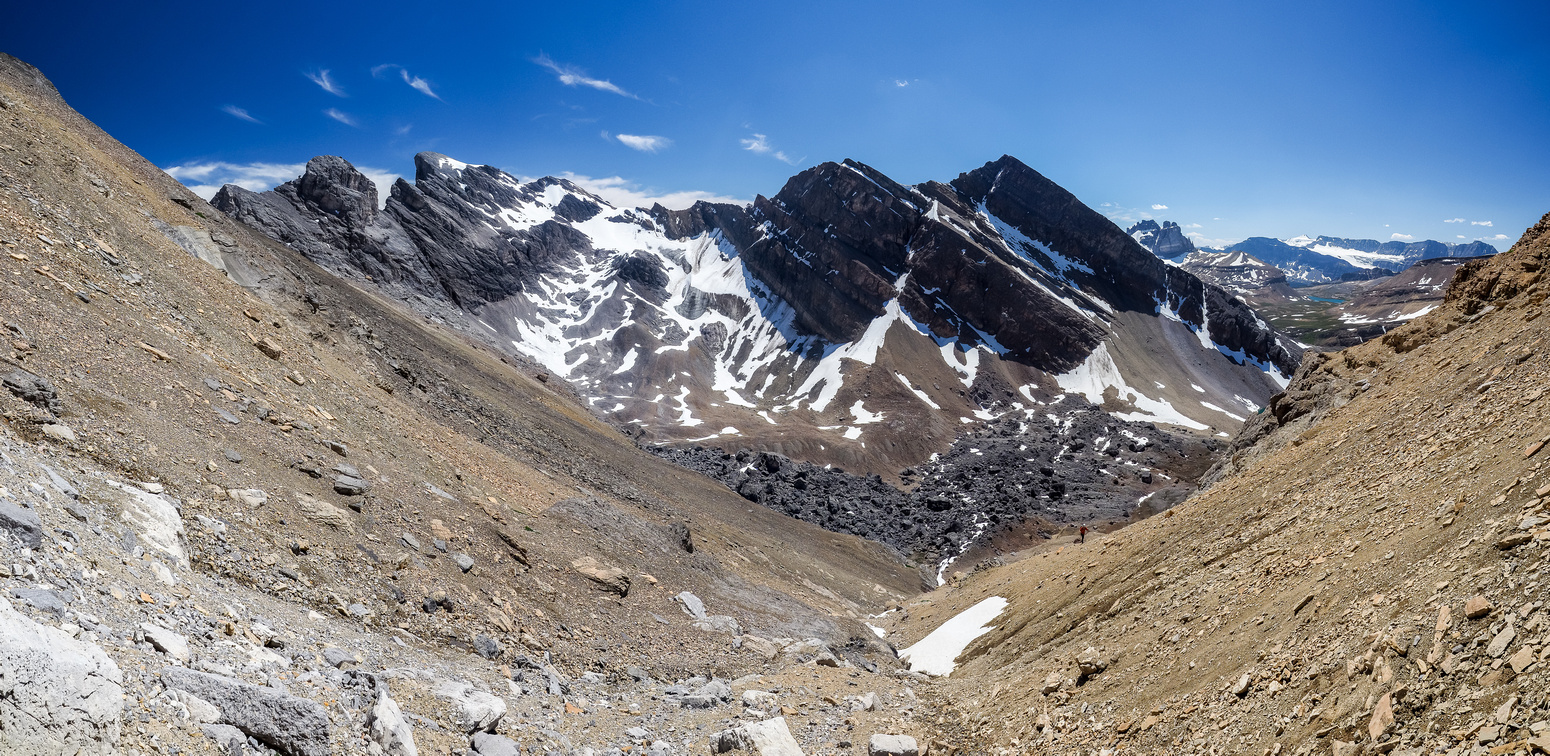 In an adjacent gully now, headed for the plateau and looking down at the boulder field, Phil and Watermelon Peak.