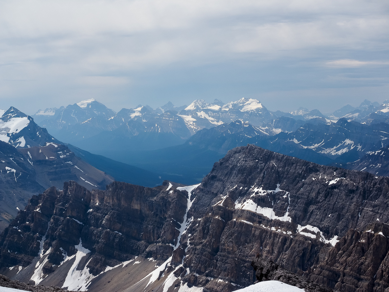 Looking towards Lake Louise with Mount Temple, Lefroy, Hungabee and Victoria visible through the atmospheric haze and the smoke from BC forest fires.