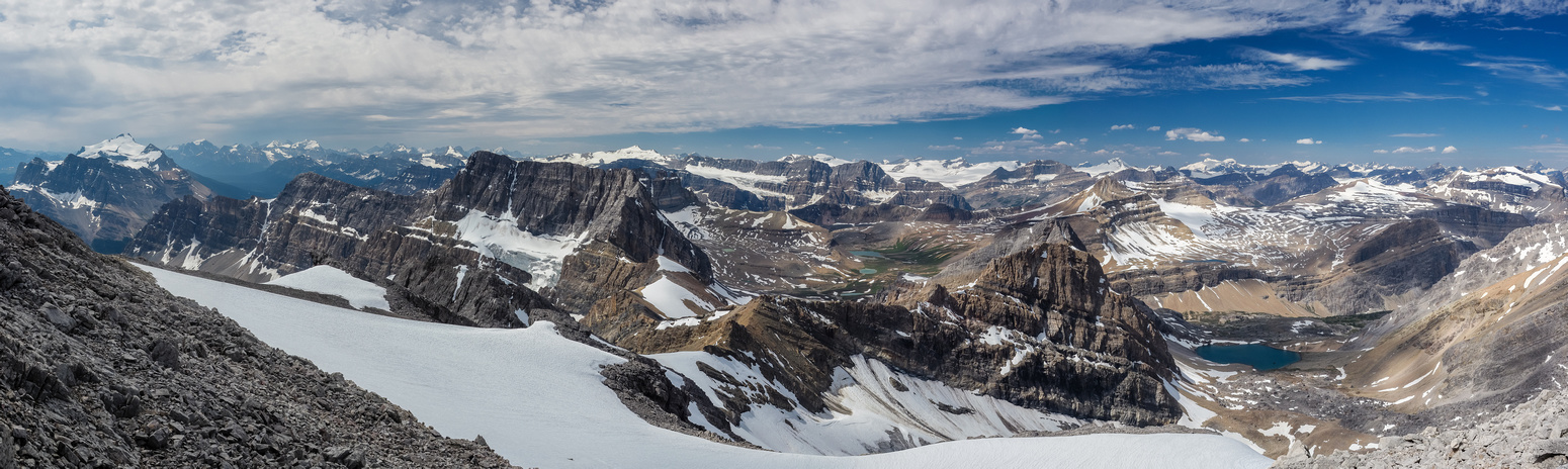 From L to R, familiar peaks looking south and west include Andromache, Hector, Balfour, Crowfoot, Gordon, Collie, Portal, Thompson, Cirque, Baker, Mummery and many others.