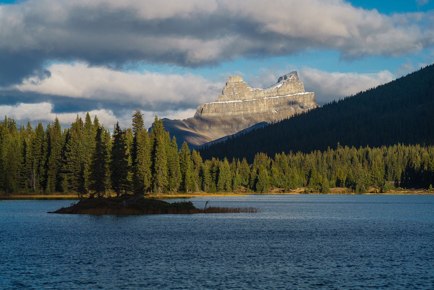 Molar Mountain rises dramatically above the upper Red Deer Lake.