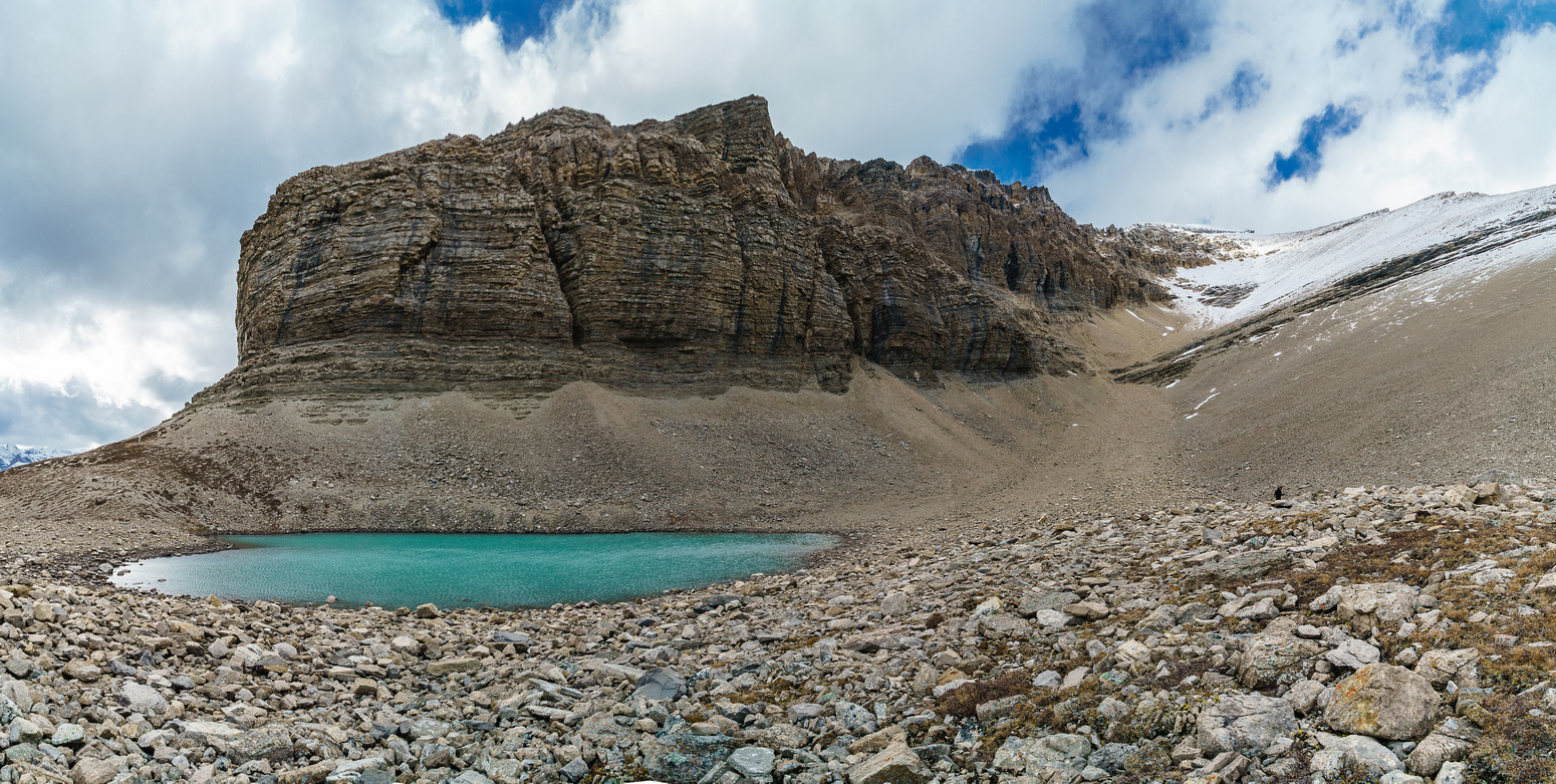 Drummond Tarn with the long, foreshortened ascent gully to the false summit on the right.