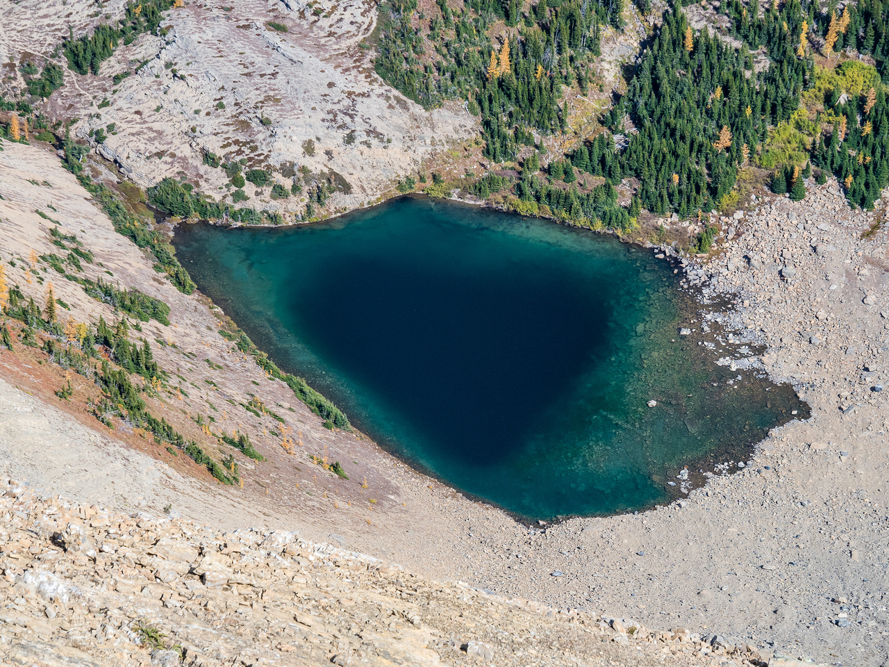 The lower, Middlepass Lake. Note the trail at upper left.