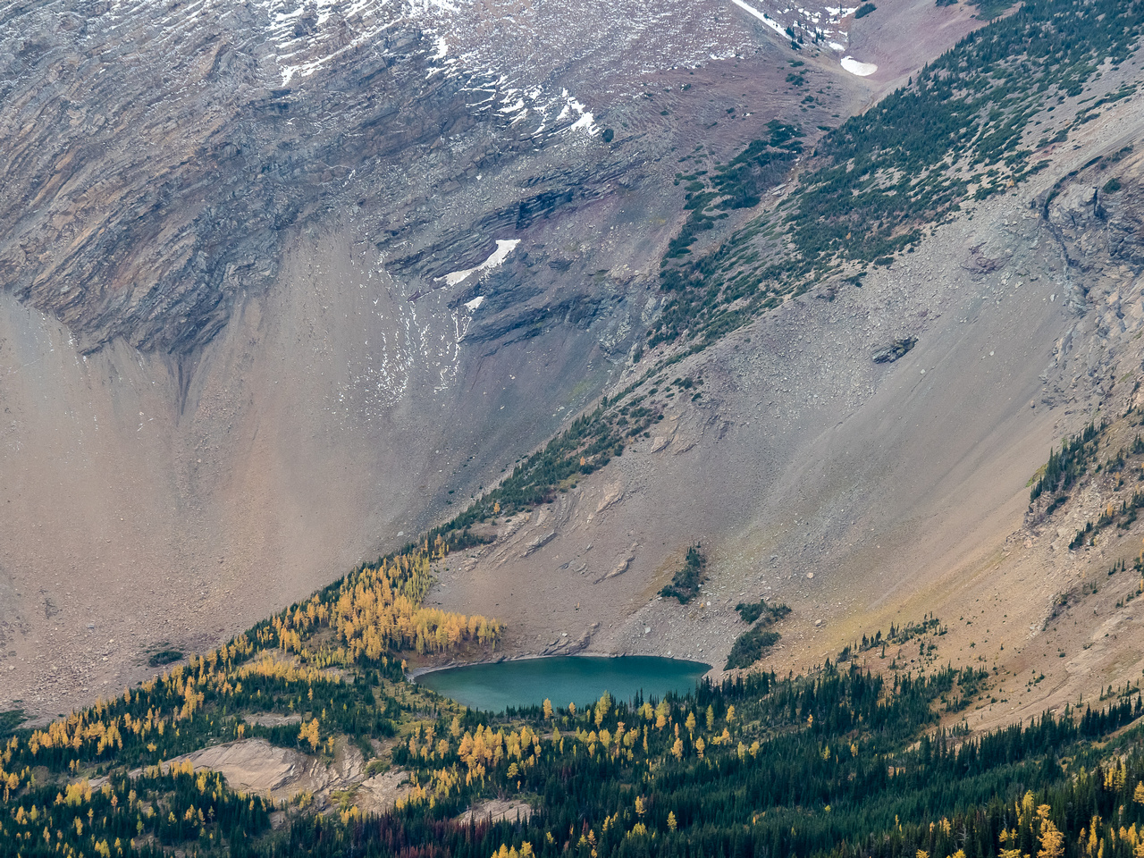 The smallest of the Rainy Lakes is tucked under the north aspect of Jake Smith Peak.