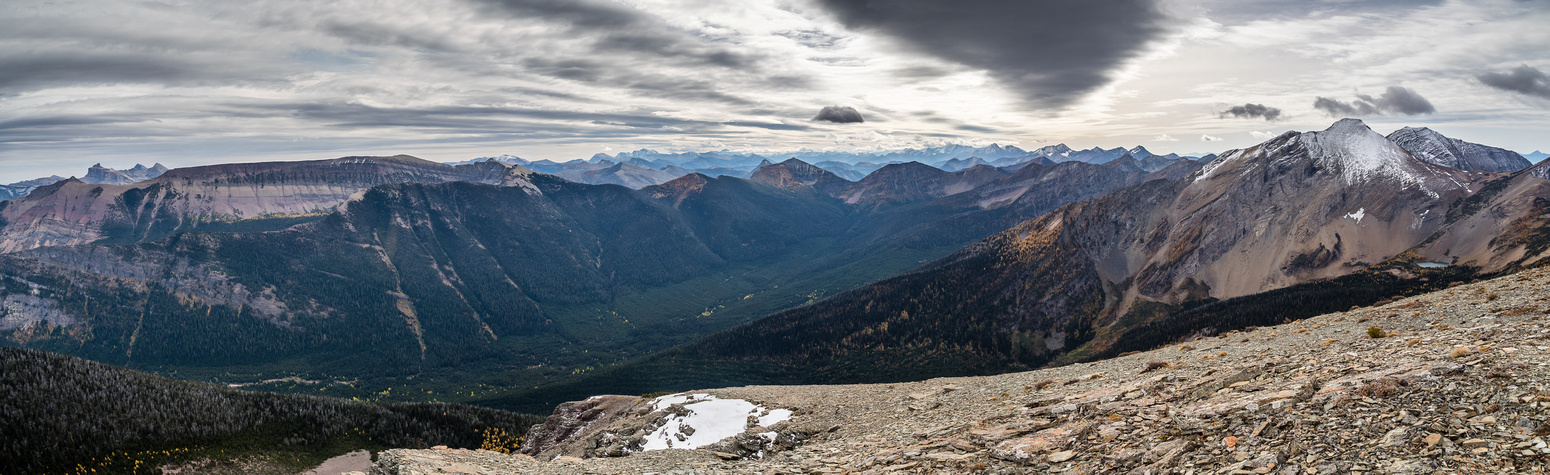 Views from the summit up the West Castle River towards South Kootenay Pass include West Castle, Castle, Windsor, Lys Ridge, Barnaby Ridge, Jutland, La Coulotte, Jake Smith and Scarpe (L to R).