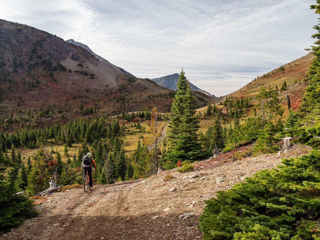 """Finally the trail """"levels"""" enough to ride again. The pass is obvious just ahead of us here. The west shoulder of Rainy Ridge at left."""