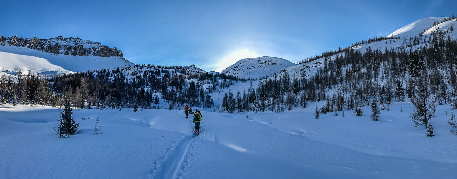 Looking ahead at our ascent options. We can go left around tree line under Unity Peak or right - straight up Wolverine Ridge.