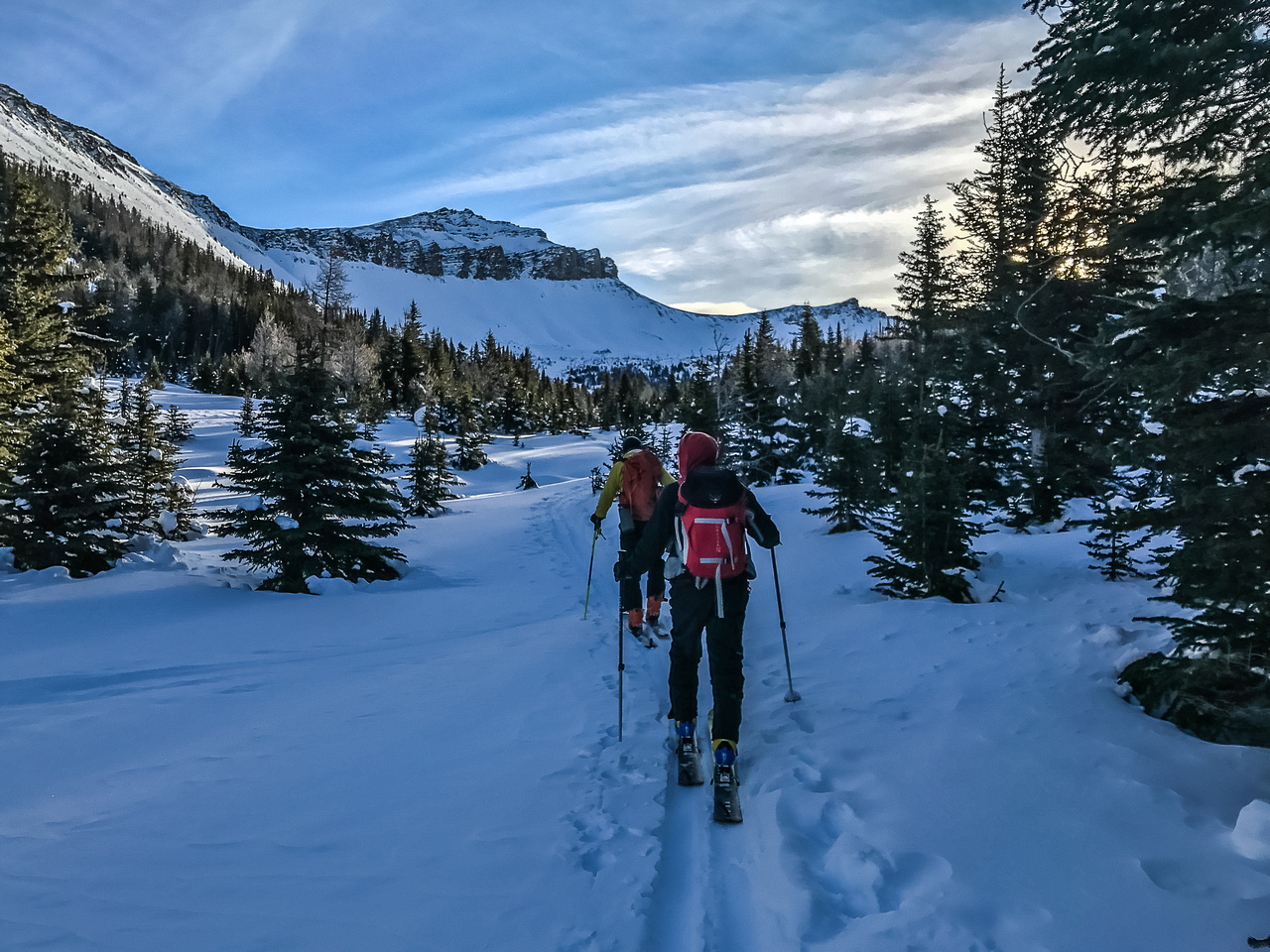 We start to warm up as the sun hits the Wolverine Valley - Unity Peak ahead.